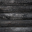 Stock Photo: Charred wooden house wall