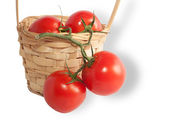 Red ripe tomatoes in basket — Stockfoto