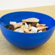 Fruit chips in blue plastic bowl — Stock Photo #38259073