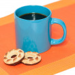Stock Photo: Cup coffee and two cookies on orange napkin