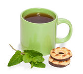 Green cup of tea, cookies and mint leaves isolated — Stock fotografie