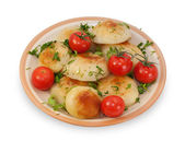 Fried potatoes with cherry tomatoes isolated — Stock Photo