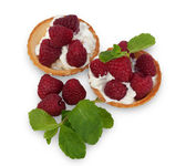 Tartlets with strawberries, whipped cream and mint leaves isolat — Stock Photo
