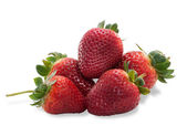 Several strawberries with leaves isolated  — Stock Photo