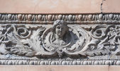 Decor on a historic building in form female head — Stock Photo