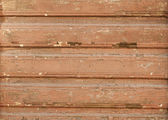 Texture of wooden brown wall crumbling — Stock Photo