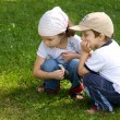 Stock Photo: Boy and girl looking