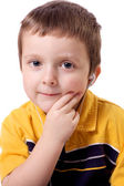 Cute little boy listening to music — Stock Photo