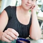 Woman having a coffee — Stock Photo #22597411