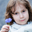 Royalty-Free Stock Photo: Girl holding a flower