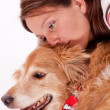 Young woman with her golden retriever — Stock Photo