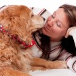 Young woman and golden retriever — Stock Photo
