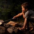 Boy cooking marshmallow — Stock Photo #22715031