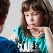 Girl and boy playing chess — Stock Photo
