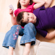 Stock Photo: Children chilling on floor