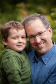 Father and son smiling — Stock Photo