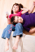 Children chilling on a the floor — Stock Photo