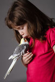 Girl with a cockatiel — Stock Photo