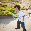 Boy playing jump rope - Stock Photo