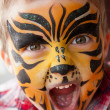 Boy with a tiger make-up — Stock Photo