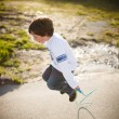 Stock Photo: Boy playing jump rope