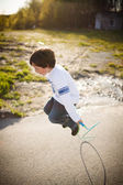 Boy playing jump rope — Stock Photo