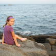 Little girl siting by the sea — Stock Photo #24222285