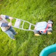 Boy playing outside - Stock Photo