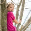 Girl in a tree — Stock Photo
