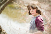 Boy by a river — Stock Photo