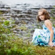 Girl playing near the water — Stock Photo