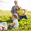 Family on the grass — Stock Photo