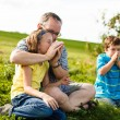 Father and children trying to whistle — Stock Photo