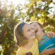 Brother and sister in an orchard — Stock Photo #26012259