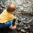Baby sitting in water — Stock Photo