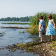 Stock Photo: Brother and sister by lake
