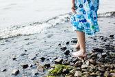 Girl walking in water — Stock Photo