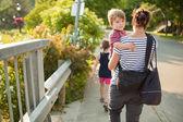 Family walking outside — Stock Photo