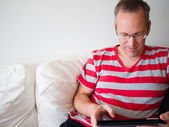 Man reading on a tablet — Stock Photo