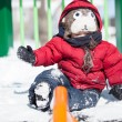 Infant playing in the snow — Stock Photo