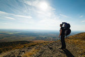 Mother and son at the top of a mountain — Stock Photo