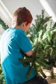 Boy building a Christmas tree — Stock Photo