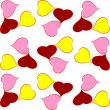 Red yellow pink hearts in seamless background — Stockvektor