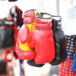 Rea and black boxing glove for sell in market — Stock Photo