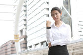Picture of attractive businesswoman with watch — Stock Photo