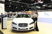 NONTHABURI - NOVEMBER 28: Jaguar XF car with unidentified model — Stock Photo