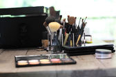 Various cosmetics set and brush on the table — 图库照片