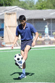 Soccer player juggle the ball with his feet — Stock Photo