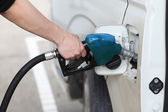 Closeup of a man's hand refilling a car with a petrol,gasoline — Stock Photo