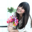 Portrait of young woman smile with flower in her hand  — Stock Photo #46520567